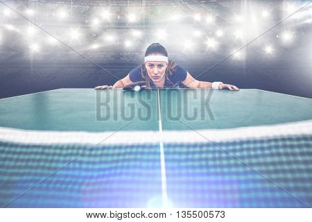 Composite image of confident female athlete leaning on hard table in a stadium