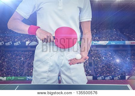 Composite image of female athlete playing table tennis in a stadium