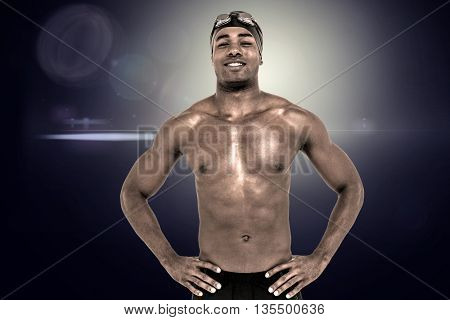 Composite image of swimmer smiling and posing with hands on hips against light