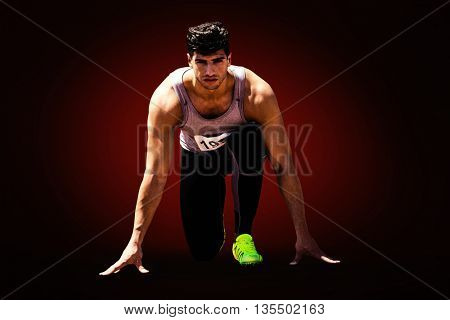 Composite image of sportsman waiting on the starting line against red background