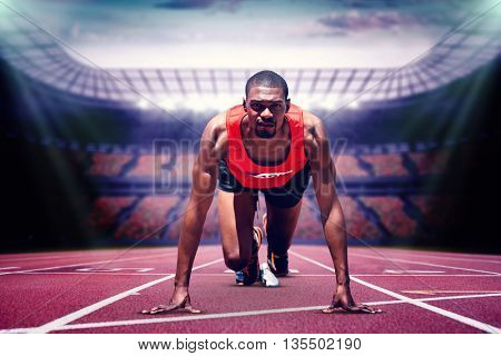 Composite image of athlete man in the starting block in a stadium