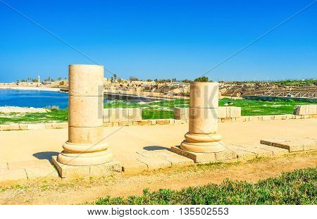 The remains of the stone columns of the Roman temple with the large hippodrome on the seashore Caesaria Israel.