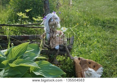 Baba yaga and her faithful grey cat, linked from threads using the hook. On a walk around the wicker fence from twigs