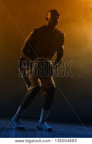 Portrait of basketball player preparing to score on a gym