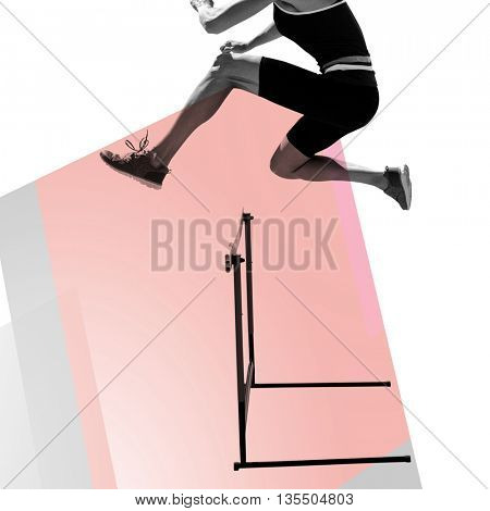 Composite image of woman practicing hurdles against colored background