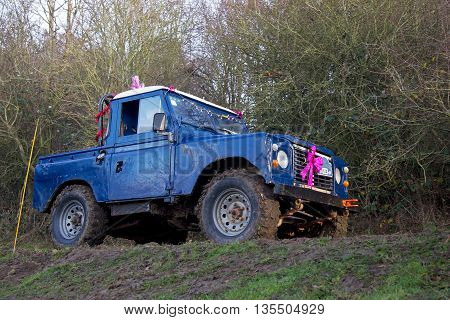 GREAT MALVERN, UK - DECEMBER 8: An unnamed driver competing in the SCOR UK trials championship negotiates a steep ditch and bank gate at the Croft Farm round on December 8, 2013 in Great Malvern