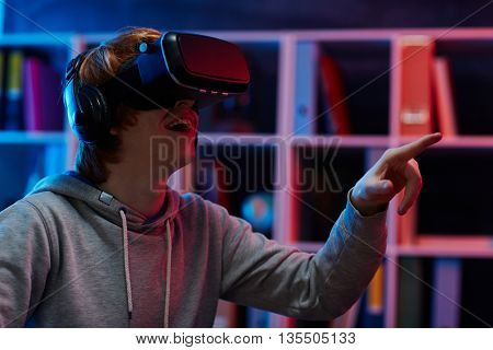 Young man admiring vr experience