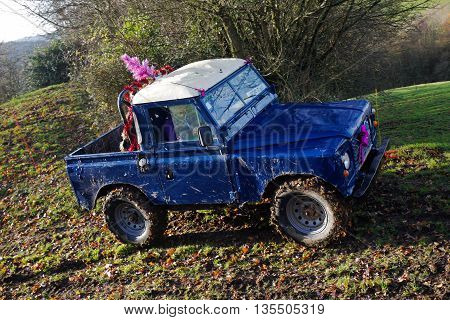 GREAT MALVERN, UK - DECEMBER 8: An unnamed driver competing in the SCOR UK trials championship negotiates a steep sided hillside at the Croft Farm round on December 8, 2013 in Great Malvern
