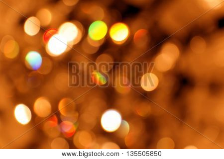 Blurred reflections of the light. Unfocused image of multi-colored light.