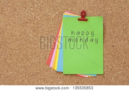 happy monday written on color sticker notes over cork board background