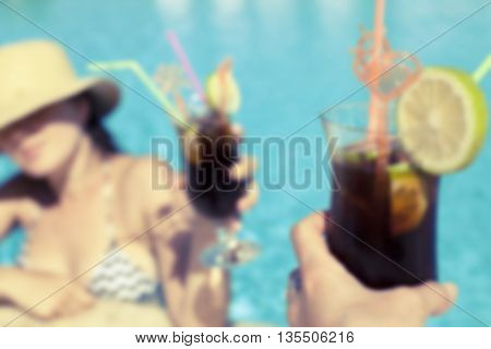 Cocktails in pool bar concept blurred photo