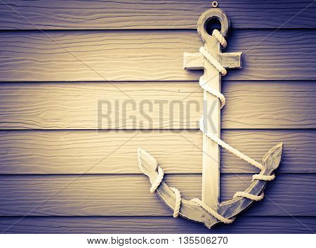 close up wooden anchor on wall vintage background vignette