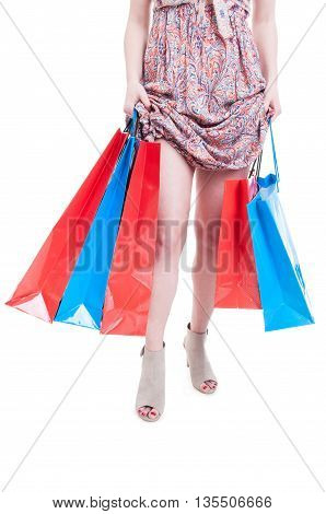 Fashionable Young Woman Holding Shopping Bags And Showing Her Legs
