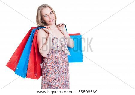 Fashion Portrait Of Cheerful Young Woman Holding Shopping Bags