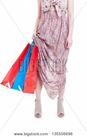 Low Section Of A Trendy Woman Carrying Shopping Bags