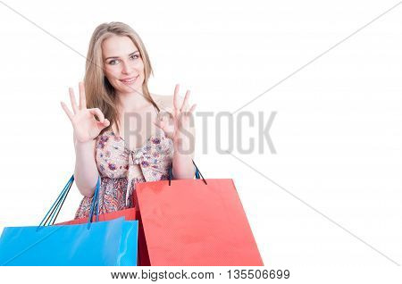 Beautiful Young Woman With Colored Gift Bags Doing Ok Gesture