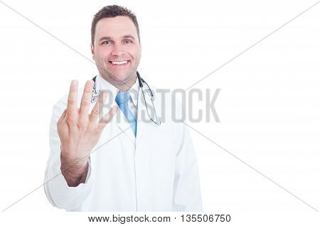 Young Doctor Smiling And Showing Number Four With One Hand