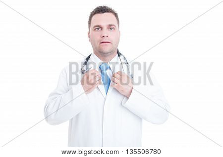 Male Doctor Standing And Adjusting Necktie With Both Hands