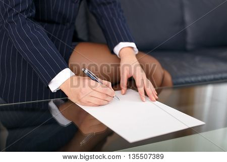 Businesswoman sign blank paper in formal wear closeup