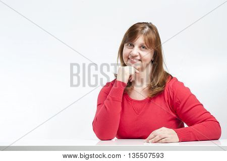 Middle-aged Woman Sitting With His Elbows On The Table..