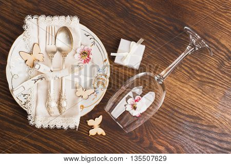 Utensil and silverware with different decorations on the wooden background