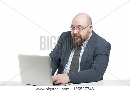 Man In A Jacket Works At The Computer..