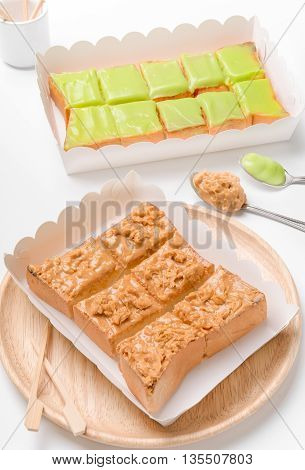 Sweetened condensed milk strawberry jam peanut butter on slice bread toast isolated on white background.