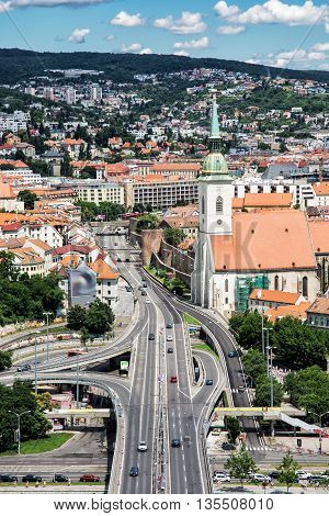 Saint Martin's cathedral and bridge SNP in Bratislava Slovak republic. Architectural theme. Capital city. Cultural heritage. Travel destination. Beautiful place. Vertical composition.