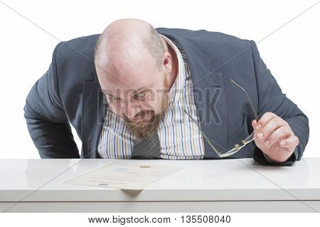 A Man In A Jacket Carefully Studying The Document. In Isolation..