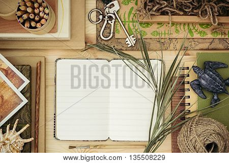 The workplace traveler. The blank notebook. The presentation. Adventure vacation background. Craft hipster wood background.