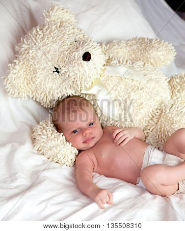 Baby With Big White Teddy Bear At Home