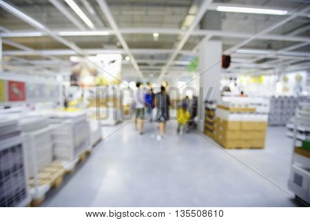 Blurred Background Image of People shopping in Warehouse or Storehouse