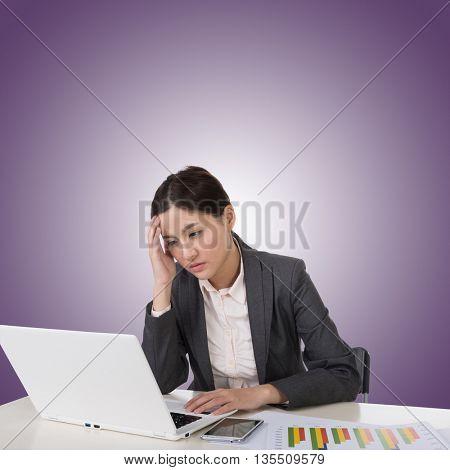 Worried business woman of Asian using laptop on desk, closeup portrait.
