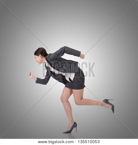Asian businesswoman runing, side view full length portrait.