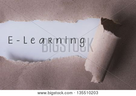 torn paper with E-Learning word. Copyspace area.