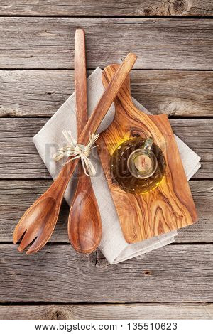 Cooking utensils and olive oil on wooden table. Top view