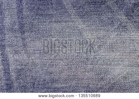 Texture jeans backgroundPerspective and closeup view to abstract space of empty light blue natural clean denim texture for the traditional business background in cold bright colors