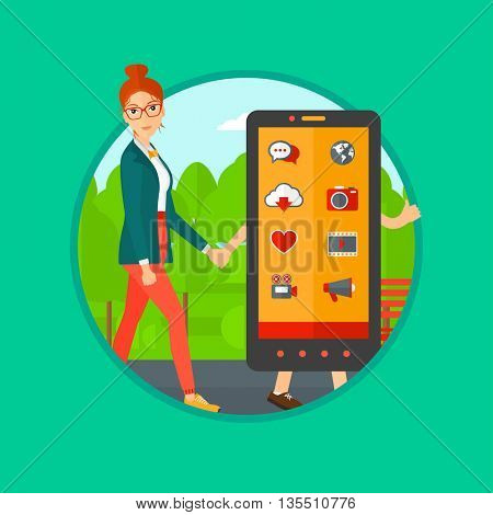 Young woman walking with a big smartphone. Woman and a big smartphone in the park. Woman holding the hand of smartphone. Vector flat design illustration in the circle isolated on background.