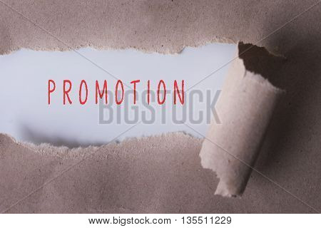 torn paper with PROMOTION word. Copyspace area.