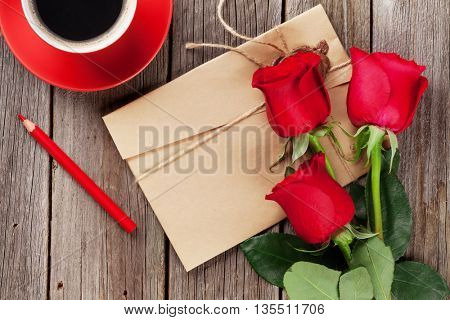 Love letter and red roses on wooden table. Valentines day concept