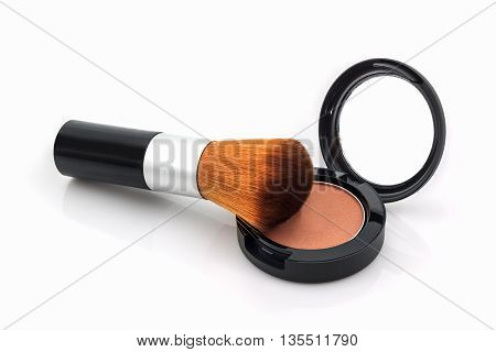 Closeup of face powder and makeup brush on white background.