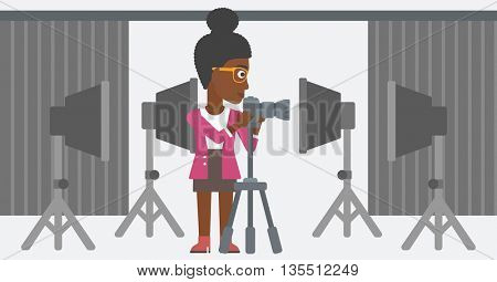 An african-american photographer working with camera on the background of photo studio with lighting equipment vector flat design illustration. Horizontal layout.