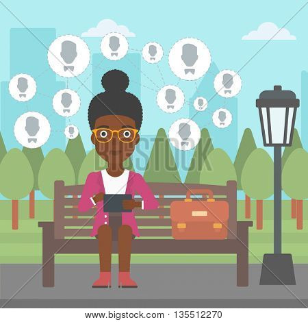 An african-american woman sitting on a bench in the park and holding a tablet computer with many avatar icons above vector flat design illustration. Square layout.