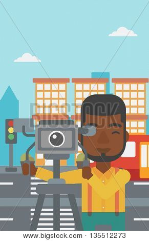 An african-american man looking through movie camera on a city background vector flat design illustration. Vertical layout.