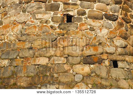 The texture of the walls of ancient fortress tower. Architecture exterior background