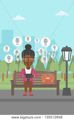 An african-american woman sitting on a bench in the park and holding a tablet computer with many avatar icons above vector flat design illustration. Vertical layout.