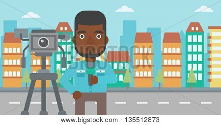 A camera filming and an african-american  reporter standing with a microphone on a city background vector flat design illustration. Horizontal layout.