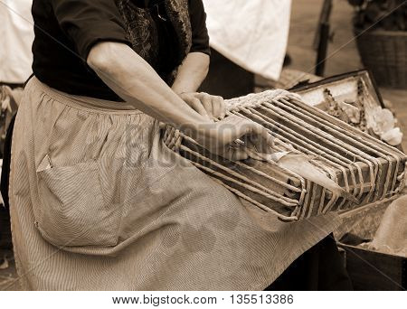 Old Woman Working With Her Hands Creates An Handmade Bag