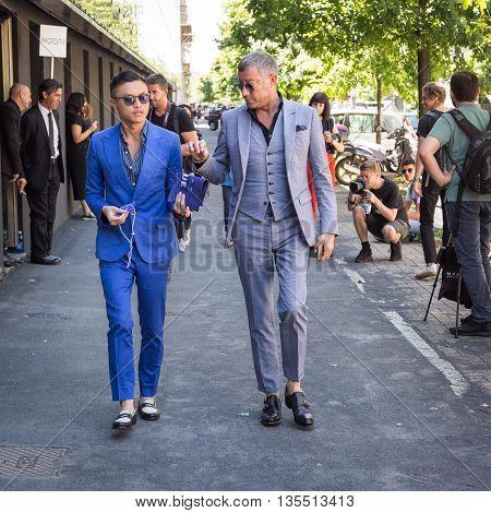 MILAN ITALY - JUNE 20: Fashionable people gather outside Etro fashion show building during Milan Men's Fashion Week on JUNE 20 2016 in Milan.