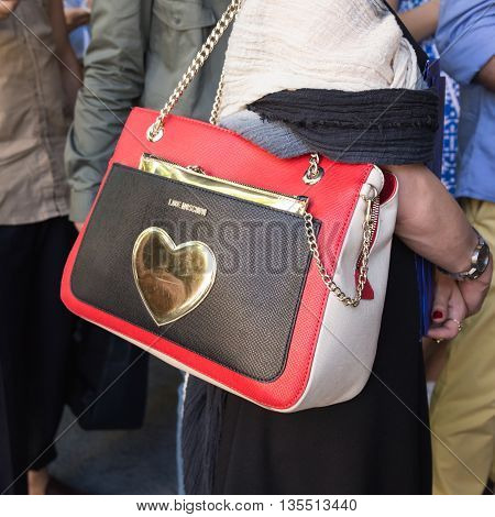 MILAN ITALY - JUNE 20: Detail of bag outside Etro fashion show building during Milan Men's Fashion Week on JUNE 20 2016 in Milan.